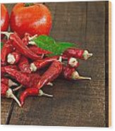 Dried Red Chillies And Tomato On A Rustic Wooden Table Wood Print