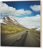 Driving in Iceland - road and mountain landscape Wood Print
