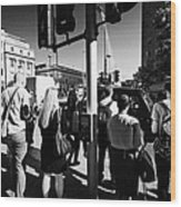 early morning commuters waiting to cross the road pedestrian crossing London England UK Wood Print