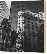 edificio ariztia building reflected in modern bank buildings in the financial district of Santiago Chile Wood Print