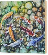 Eight Koi Fish Playing With Bubbles Wood Print