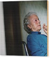 Elderly Woman Sitting In A Wheel Chair Wood Print