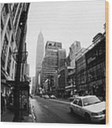 Empire State Building Shrouded In Mist As Yellow Cab Taxi New York City Wood Print by Joe Fox