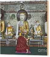 faithful Buddhist monk praying at Buddha Statues in SHWEDAGON PAGODA Wood Print