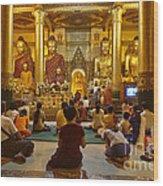 faithful Buddhists praying at Buddha Statues in SHWEDAGON PAGODA Yangon Myanmar Wood Print