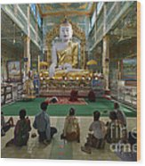 faithful Buddhists praying at sitting Buddha in golden Ponnya Shin Pagoda Wood Print