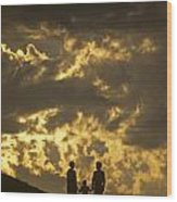 Family On Hillside Holding Hands And Facing Life Together. Wood Print