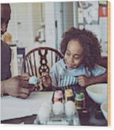 Father And Boy Colouring Easter Egg Together Wood Print