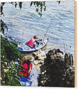 Father And Son Launching Kayaks Wood Print