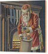 Father Christmas Filling Children's Stockings Wood Print