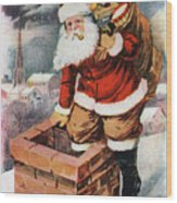 Father Christmas Popping Down The Chimney To Deliver Gifts To The Good.  Wood Print