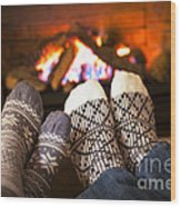 Feet Warming By Fireplace Wood Print