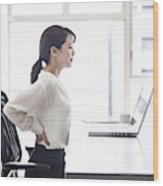 Female employees are suffering from low back pain Wood Print