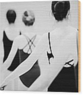 Female Teenage Ballet Students Holding On To A Ballet Barre At A Ballet School In The Uk Wood Print by Joe Fox