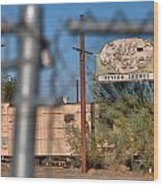 Fenced In  Abandoned 1950's Motel Trailer Wood Print