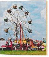 Ferris Wheel Against Blue Sky Wood Print