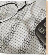 Financial Spreadsheet With Calculator And Glasses Wood Print
