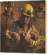Fire Fighters Rescuing A Baby Wood Print by Don Hammond