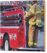 Fireman On Back Of Fire Truck Wood Print