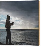 Fisherman Fishing While Storm Blows Wood Print