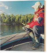 Fisherman Sitting On Foredeck Wood Print