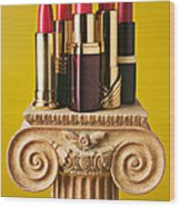 Five Red Lipstick Tubes On Pedestal Wood Print