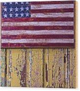 Flag On Old Yellow Door Wood Print