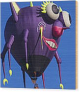Floating Purple People Eater Wood Print by Garry Gay