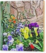 Flowers By The Wall Wood Print