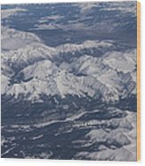 Flying Over The Snow Covered Rocky Mountains Wood Print