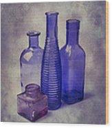 Four Glass Bottles Wood Print