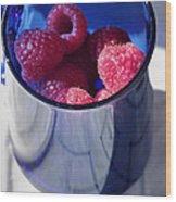 Fresh Raspberries In A Blue Cup Wood Print