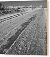 frozen salt and grit covered rural small road in Forget Saskatchewan Canada Wood Print