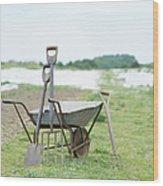 Gardening Tools And Wheel Barrow On Wood Print