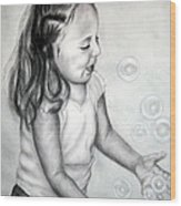 Girl Blowing Bubbles II Wood Print