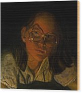 Girl In Glasses In Candlelight Wood Print