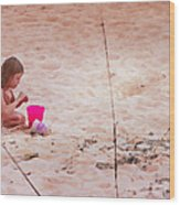 Girl In The Sand Wood Print