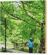 Girl Jogging With Dog Wood Print