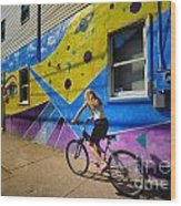 Girl Rides Bicycle Past Mural On The South Side Of Pittsburgh Wood Print