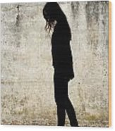 Girl Walking In Front Of Cement Wall Wood Print