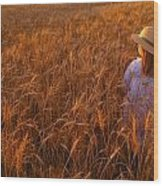 Girl With Hat In Field Wood Print
