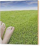 Girls Feet On Grass With Flowers Wood Print