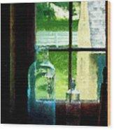 Glass Bottles On Windowsill Wood Print