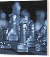 Glass Chessmen Arranged On Black Background Wood Print