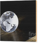 Glass Globe On Wooden Floor Wood Print