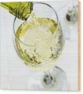 Glass Of White Wine Being Poured Wood Print