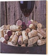 Glass Of Wine With Corks Wood Print