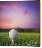Golf Ball On Tee At Sunset Wood Print by Michal Bednarek