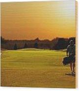 Golfer Walking On A Golf Course Wood Print