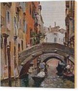 Gondola On A Venetian Canal Wood Print
